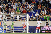 Fredy Montero (17) of the Seattle Sounders runs behind the goal as he celebrates scoring the game's only goal as Tim Ream (5) of the New York Red Bulls digs the ball out of the net. The Seattle Sounders defeated the New York Red Bulls 1-0 during a Major League Soccer (MLS) match at Red Bull Arena in Harrison, NJ, on May 15, 2010.