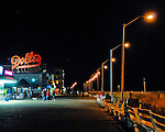 Dolles is a fixture, anchoring the intersection between Rehoboth Avenue and the boardwalk.  Even at night, the Dolles sign is a landmark on the boardwalk.  Rehoboth Beach, Delaware, USA. © Rick Collier