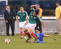 Mexioco Aldo De Nigris (9) gets fouled.  Mexico defeated Guatemala 2-1 in the quaterfinals for the 2011 CONCACAF Gold Cup , at the New Meadowlands Stadium, Saturday June 18, 2011.