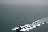 AL-BASRA OIL TERMINAL, IRAQ: A US Navy boat patrols near the off shore loading facility at the Basra Oil Terminal..
