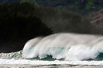 A large wave crashes on Ke'e Beach in Hanalei Bay on the island of  Kaua'i, Hawaii
