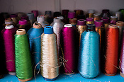 Spools of colour threads seen in Sophie 203 workshop in Jaipur, Rajasthan, India.