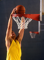 Basketball player dunking the ball.