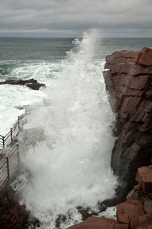 Explosive ocean spray and a thunderous roar burst from a narrow slot in the granite shoreline and give Thunder Hole its name in Acadia National Park, Maine, USA