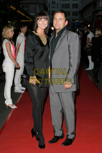 EMMA BARTON & JOEL BECKETT.The Never Forget Take That Musical - West End Transfer - gala night, Savoy Theatre, London, England. .May 22nd, 2008. full length black dress tights grey gray suit couple clutch bag gold studs.CAP/AH.©Adam Houghton/Capital Pictures.
