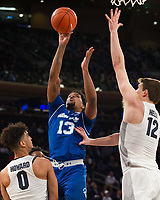 NEW YORK, NY - Thursday March 9, 2017: Myles Powell (#13) of Seton Hall goes up for a lay-up against Matt Heldt (#12) of Marquette as the two schools square off in the Quarterfinals of the Big East Tournament at Madison Square Garden.