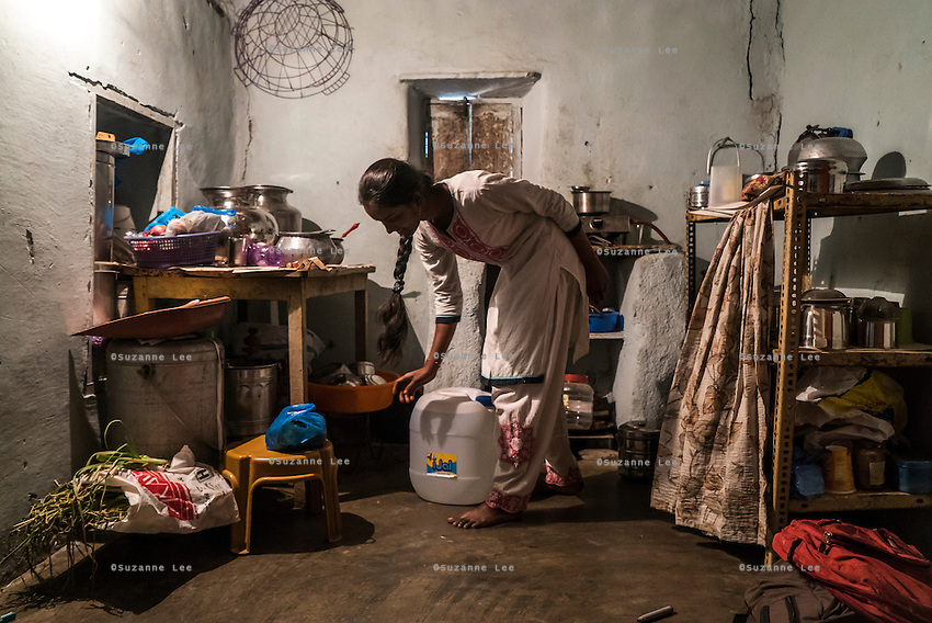 Cheekata  Srujana, 18, prepares to cook a meal for her family in Peddapur, a remote village in Warangal, Telangana, India, on 22nd March 2015. Cheekata only uses safe water for all her cooking and drinking needs of the family. Photo by Suzanne Lee/Panos Pictures for Safe Water Network