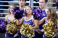 2013-09-21: Washington cheerleader Nikki Buchanan entertained fans during the game  against Idaho State.  Washington won 56-0 over Idaho State in Seattle, WA.