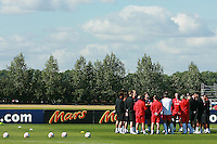 Football - England Training - Arsenal Training Grounds.Fabio Capello England Manager talks to the team before training....