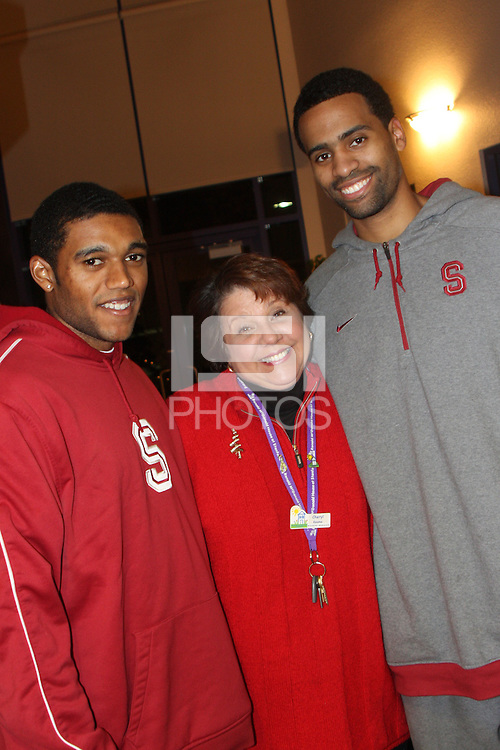 PALO ALTO, CA - DECEMBER 16:  Kenny Brown and Lawrence Hill pose with weekend manager Cheryl Keama as the Stanford Cardinal visit the Ronald McDonald House for the holidays on December 16, 2008 in Palo Alto, California.