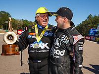 Mar 19, 2017; Gainesville , FL, USA; NHRA funny car driver John Force (left) celebrates with runner up Jonnie Lindberg after winning the Gatornationals at Gainesville Raceway. Mandatory Credit: Mark J. Rebilas-USA TODAY Sports