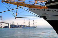 With the bow of the Russian merchant marine full-rigged training ship the Pallada in the foreground the Cuauht&eacute;moc passes in front of Treasure Island in San Francisco Bay.<br />