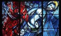 Christ's descent from the cross, stained glass window, 1974, by Marc Chagall, 1887-1985, with the studio of Jacques Simon, in the axial chapel of the apse of the Cathedrale Notre-Dame de Reims or Reims Cathedral, Reims, Champagne-Ardenne, France. The cathedral was built 1211-75 in French Gothic style with work continuing into the 14th century, and was listed as a UNESCO World Heritage Site in 1991. Picture by Manuel Cohen