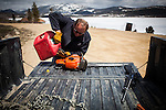 Former Montana Governor Brian Schweitzer gases up his chainsaw at his Georgetown Lake home in Anaconda, Montana, May 7, 2014.<br /> CREDIT: Max Whittaker/Prime for The Wall Street Journal<br /> BRIAN