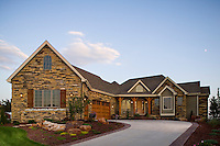 Exterior view of luxury stone home located in Fort Collins, Colorado.