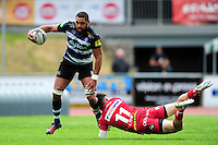 Taulupe Faletau of Bath Rugby is tackled by Steffan Evans of the Scarlets. Pre-season friendly match, between the Scarlets and Bath Rugby on August 20, 2016 at Eirias Park in Colwyn Bay, Wales. Photo by: Patrick Khachfe / Onside Images