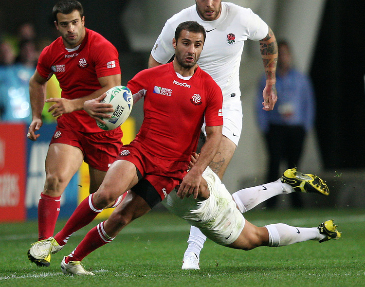Georgia's Merab Kvirikashvili runs the ball against England in the Rugby World Cup pool match at Otago Stadium, Dunedin, New Zealand, Sunday, September 18, 2011. Credit:SNPA / Dianne Manson.