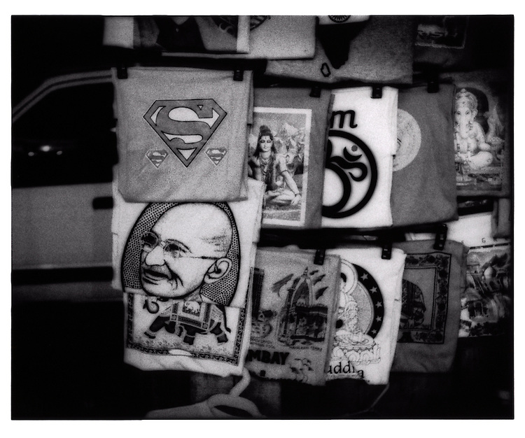 Gandhi, aum, Ganesh and Superman, vendor's stall, Colaba district, Mumbai, India.