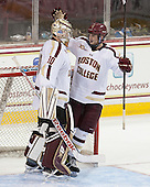 Scott Savage (BC - 28) celebrates with Thatcher Demko (BC - 30) who recorded his first collegiate win. - The Boston College Eagles defeated the visiting Rensselaer Polytechnic Institute Engineers 7-2 on Sunday, October 13, 2013, at Kelley Rink in Conte Forum in Chestnut Hill, Massachusetts.