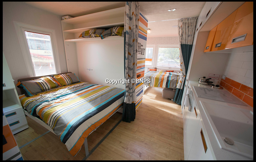 BNPS.co.uk (01202 558833)<br /> Pic: LauraDale/BNPS<br /> <br /> The caravan's double bed on the left and two interior walls pushed forward to allow the bed to come down.<br /> <br /> A new mobile home that has movable walls to maximise the space the owner is using at the time is set to revolutionise the humble caravan holiday.<br /> <br /> The Concept Caravan measures 30ft by 13ft and uses the same area for different functions at different times.<br /> <br /> During the day, the movable bedroom wall is pushed back, freeing up an extra 60sq ft of room to create and impressive open-plan living space that has room for a 10 seater dining table.<br /> <br /> At night, the wall comes out and with it a foldaway bed to form a comfortable double bedroom.