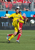 18 May 2013: Columbus Crew midfielder/forward Eddie Gaven #12 and Toronto FC midfielder Matias Laba #20 in action during the first half in an MLS game between the Columbus Crew and Toronto FC at BMO Field in Toronto, Ontario Canada....