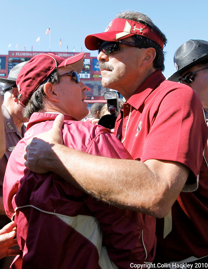 TALLAHASSEE, FL 10-FSU-BC 101610 FB10 CH-Florida State Head Coach Jimbo Fisher, left, is congratulated by Boston College Head Coach Frank Spaziani after the Semionles beat the Eagles 24-19 Saturday at Doak Campbell Stadium in Tallahassee. TCOLIN HACKLEY PHOTO