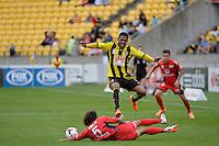 Kenny Cunningham and Osama Malik  during the A League - Wellington Phoenix v Adelaide United, Wellington, New Zealand on Sunday 30 March 2014. <br /> Photo by Masanori Udagawa. <br /> www.photowellington.photoshelter.com.