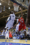 15 November 2014: Duke's Justise Winslow (12) block a shot by Fairfield's Marcus Gilbert (14). The Duke University Blue Devils hosted the Fairfield University Stags at Cameron Indoor Stadium in Durham, North Carolina in an NCAA Men's Basketball exhibition game. Duke won the game 109-59.