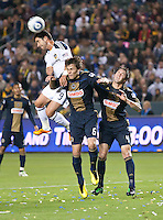 CARSON, CA – April 2, 2011: LA Galaxy forward Juan Pablo Angel (9) goes up high to head ball past Philadelphia Union midfielder Stefani Miglioranzi (6) and defender Danny Califf (4) during the match between LA Galaxy and Philadelphia Union at the Home Depot Center, March 26, 2011 in Carson, California. Final score LA Galaxy 1, Philadelphia Union 0.