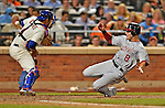 24 July 2012: Washington Nationals infielder Danny Espinosa slides home safely to score on a Jesus Flores double against the New York Mets at Citi Field in Flushing, NY. The Nationals defeated the Mets 5-2 to take the second game of their 3-game series. Mandatory Credit: Ed Wolfstein Photo
