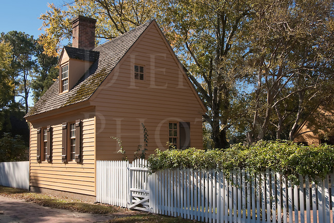 A small colonial house with white picket fence in Williamsburg, VA, USA.