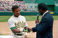 OAKLAND, CA - Rickey Henderson of the Oakland Athletics shakes hands with Lou Brock after setting the all time career stolen base record by stealing base #939 during a game against the New York Yankees at the Oakland Coliseum in Oakland, California on May 1, 1991. Photo by Brad Mangin