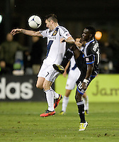 Robbie Keane of Galaxy controls the ball away from Simon Dawkins of Earthquakes during the game at Buck Shaw Stadium in Santa Clara, California on November 7th, 2012.   LA Galaxy defeated San Jose Earthquakes, 3-1.