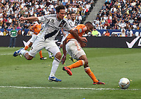 CARSON, CA - DECEMBER 01, 2012:   Todd Dunivant (2) the Los Angeles Galaxy battles for the ball lwith Ricardo Clark (13) of the Houston Dynamo during the 2012 MLS Cup at the Home Depot Center, in Carson, California on December 01, 2012. The Galaxy won 3-1.