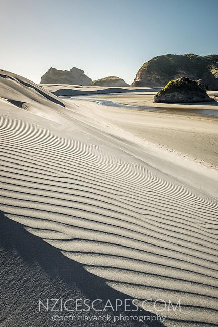 Textured, white sand dunes on Wharariki Beach on west coast of South Island, Nelson Region, South Island, New Zealand