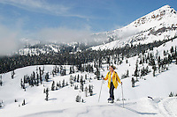 USA, California, Heather Carroll snowshoeing on a sunny winter day in Lassen Volcanic National Park.