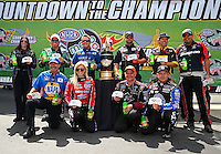 Sep 12, 2014; Concord, NC, USA; NHRA funny car drivers (front row from left) Ron Capps , Courtney Force , Tim Wilkerson , Robert Hight  (back row from left) Alexis DeJoria , John Force , Tommy Johnson Jr , Matt Hagan , Del Worsham and Cruz Pedregon pose for a photo of the ten drivers eligible for the Countdown to the Championship prior to qualifying for the Carolina Nationals at zMax Dragway. Mandatory Credit: Mark J. Rebilas-USA TODAY Sports