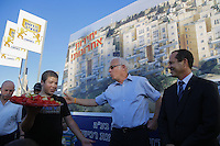 Israeli Housing Minister Uri Ariel ( 2R ) hugs Jerusalem Mayor Nir Barkat ( R ) during a corner stone laying ceremony for a new Jewish neighborhood on August 11, 2013 in East Jerusalem, Israel. Israel's Housing Ministry announced Sunday the marketing of land for the immediate construction of nearly 1,200 new units in Jewish neighborhoods in East Jerusalem and the West Bank settlement blocs.   Photo by Oren Nahshon