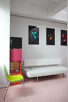 A series of Karim Rashid's creations called Bloblove hangs along one wall of the open plan living area