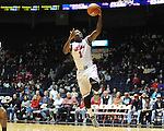 "Ole Miss' Martavious Newby (1) scores vs. Coastal Carolina at the C.M. ""Tad"" Smith Coliseum in Oxford, Miss. on Tuesday, November 13, 2012. (AP Photo/Oxford Eagle, Bruce Newman)"