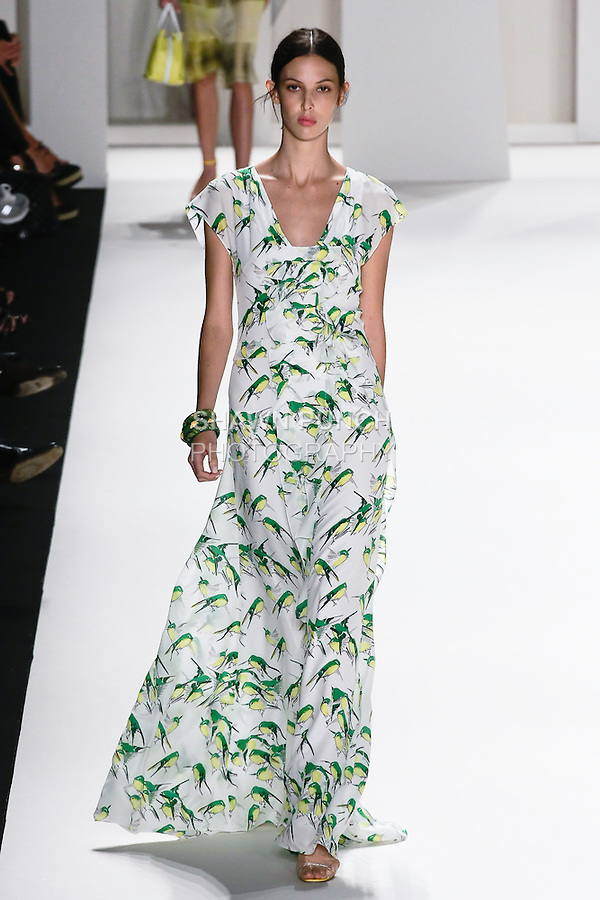 Ruby Aldridge walks the runway in a canary yellow and grass green sparrow print crepe de chine gown for the Carolina Herrera Spring 2012 fashion show, during Mercedes-Benz Fashion Week Spring 2012.
