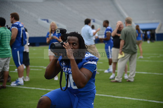 Senior Collins Ukwu plays around with a photographers camera at UK Football Media Day on Friday, August 3, 2012. Photo by Mike Weaver  Staff