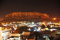 The stunning iconic Jodhpur fort by night overlooking Rajasthan's &quot;Blue City&quot;, Rajasthan, India.