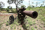 A heavily rusted U.S. 105mm cannon, a relic of the Vietnam War, sinks slowly into the ground at the former U.S. Marine base at Khe Sanh, Vietnam. April 24, 2013.