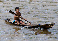 Caboclos, a mix of indigenous Indians and colonizing Portugese, in adugout canoe on the Amazon River in the Breves Narrows area.