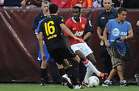 Manchester United forward Danny Welbeck (19) goes against FC Barcelona midfielder Sergio Busquets (16) Manchester United defeated Barcelona FC 2-1 at FedEx Field in Landover, MD Saturday July 30, 2011.