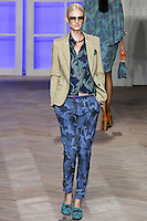 Patricia van der Vliet walks the runway in a cotton single-breasted suit jacket, blue camouflage silk long-sleeved button-down shirt, and blue camouflage cotton pleated pants with ankle straps, by Tommy Hilfiger for the Tommy Hilfiger Spring 2012 Pop Prep Collection, during Mercedes-Benz Fashion Week Spring 2012.