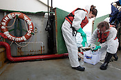 Ike Teuling and Jacob Namminga, radiation safety advisors on the Greenpeace ship Rainbow Warrior collect sea water samples to monitor radiation levels,  as the ships sails up the eastern coast of Japan on her way to Fukushima, in Japan, Tuesday 3rd May 2011..At coordirnates 36' 40.750 North, 141' 05.375 East, at 6.29am.