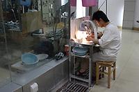 Beijing ,China- 2007 File Photo -<br /> <br /> <br /> Worker of a Jade factory.<br /> <br /> <br /> photo : James Wong-  Images Distribution