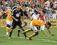 Troy Perkins #23 of D.C. United crashes into Brian Ching #25 of the Houston Dynamo during an MLS match at RFK Stadium in Washington D.C. on September  25 2010. Houston won 3-1.